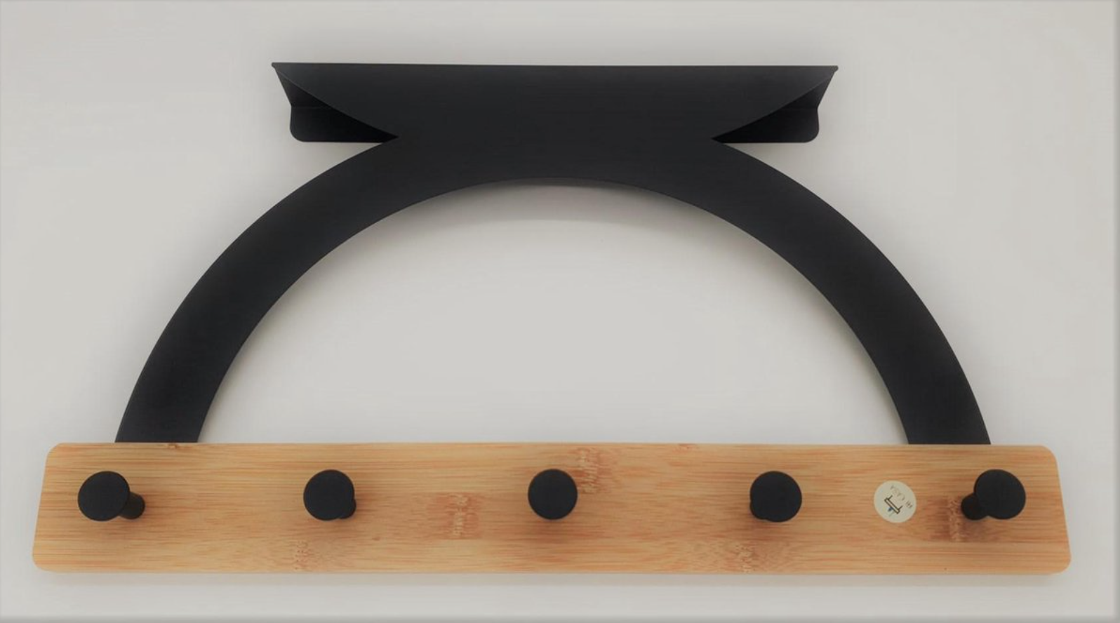 Zwarte deurkapstok van bamboe en metaal